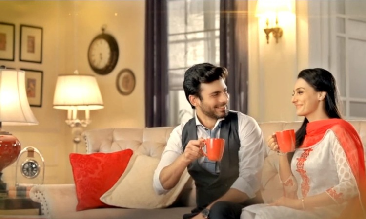 In his latest commercial for Tapal Danedar tea, Fawad overturns stereotypical gender roles by making, and then serving, his overworked wife a steaming cup of tea - Screengrab