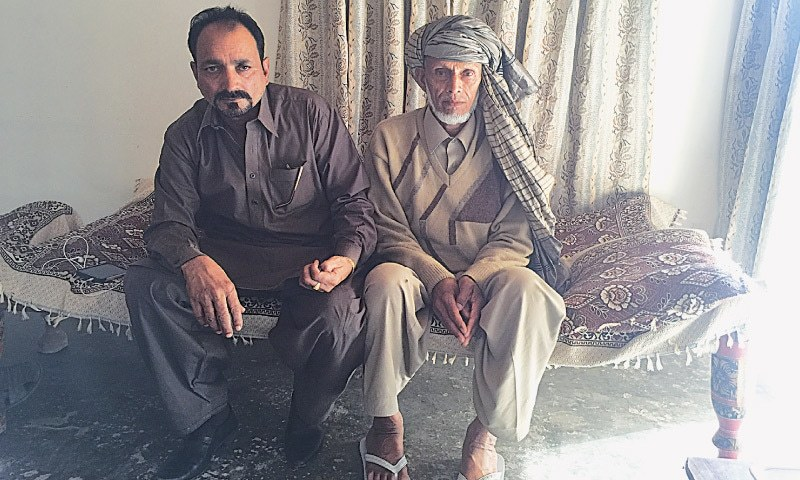 Ghulam Hussain (right) with his brother Mohammad Islam.—Photo by writer