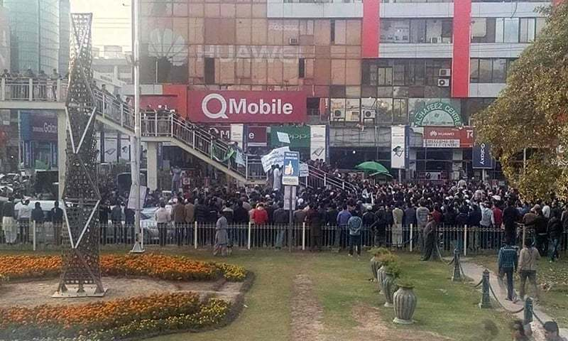 Dozens of people gathered outside Lahore's Hafeez Center protesting the arrest of a shopkeeper for putting up an anti-Ahmadi poster on Monday. –Photo courtesy Jibran Nasir Facebook