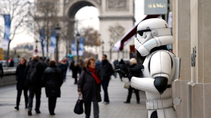 "A Storm Trooper is pictured on the Champs Elysees avenue the day before the release of the film ""Star Wars: The Force Awakens"" in Paris. ─AP"