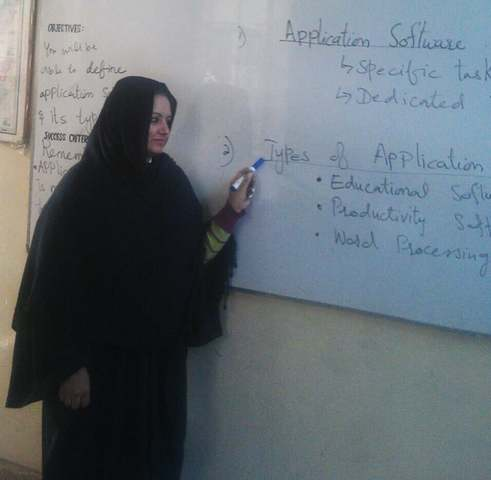 In this picture, Beenish is seen teaching in her classroom.