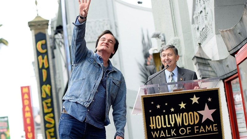 Director Quentin Tarantino attends the unveiling of his Hollywood Walk of Fame star.─ AFP