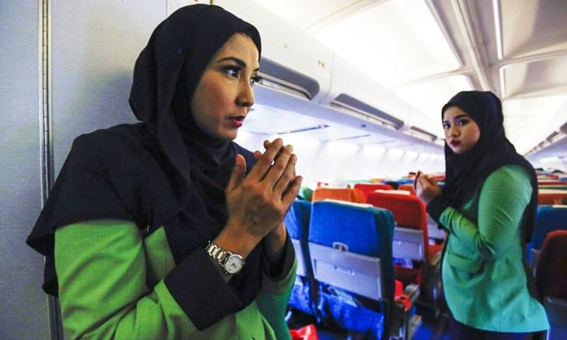 Malaysia's new Islamic airline takes off, with a prayer