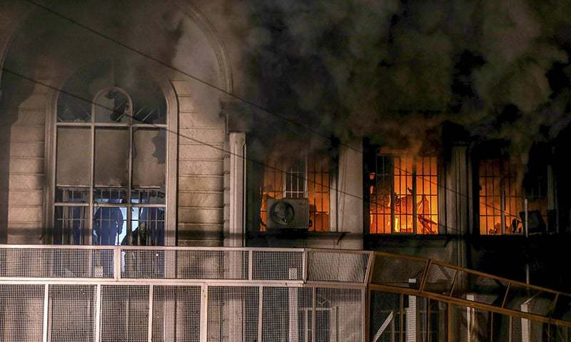 Flames and smoke rise from Saudi Arabia's embassy during a demonstration. ─ Reuters