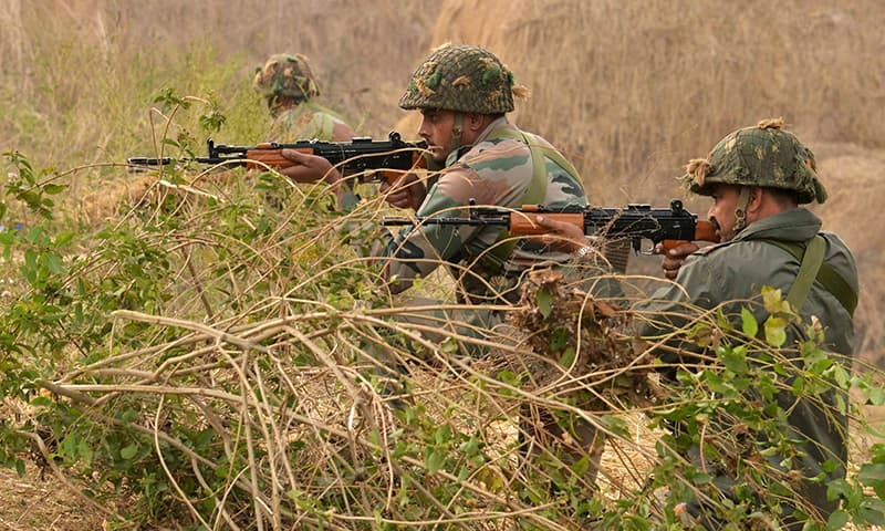 Indian army soldiers take up position on the perimeter of an airforce base in Pathankot. -AFP