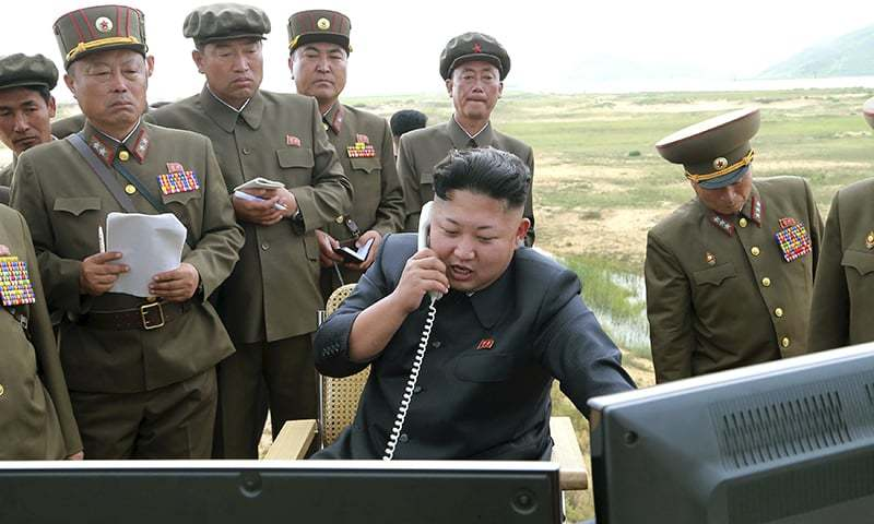 North Korean leader Kim Jung Un guides the test fire of a tactical rocket in this undated photo.─ Reuters/File