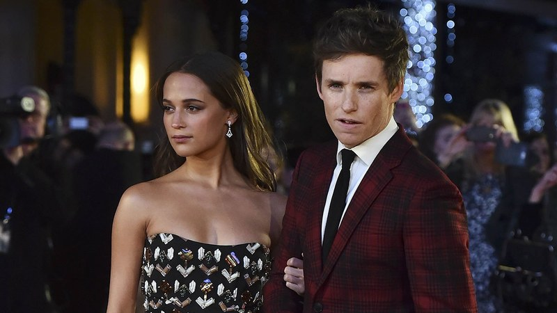Swedish actress Alicia Vikander and British actor Eddie Redmayne pose on the red carpet of the UK premiere of film 'The Danish Girl' in London. ─AFP/File