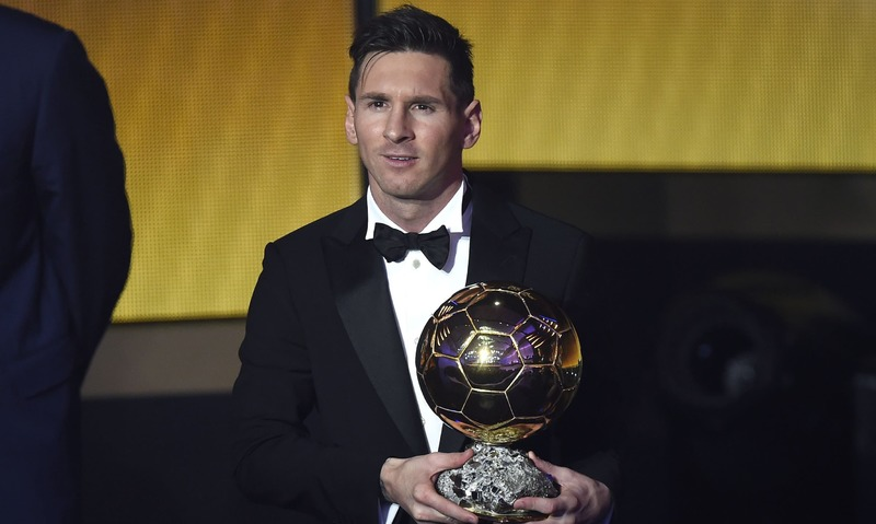 Lionel Messi Holds His Trophy After Receiving The 2015 FIFA Ballon DOr Award