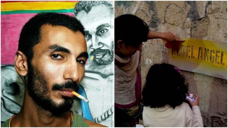 Asim Butt (R), a girl sprays 'Rebel Angel' using stencil.