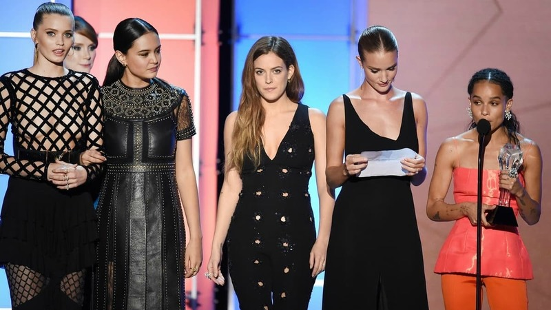 Mad Max: Fury Road actors Abbey Lee Kershaw (far left), Courtney Eaton (third from left), Riley Keough, Rosie Huntington-Whiteley and Zoe Kravitz accept the Critics' Choice award for best director on George Miller's behalf