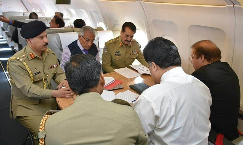 Special Assistant to Prime Minister on Foreign Affairs Tariq Fatemi,  Army Chief General Raheel Sharif and Prime Minister Nawaz Sharif can be seen onboard an aircraft enroute from Saudi Arabia to Iran. — Photo: PMO