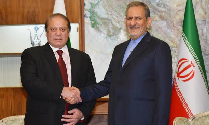 PM shakes hands with First Vice President of Iran Mr Ishaq Jahangiri.─ Photo: PID
