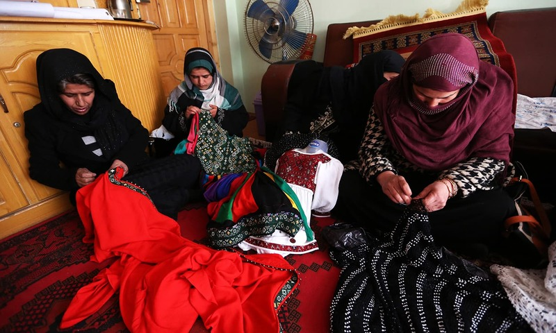 Afghan women are weaving triditional dress during a vocational training course organised by Afghanistan General association of public servants in Kabul. -AP