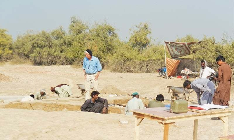 A French archaeology expert supervises excavation by labourers  at the Chahun Jo Daro site on Friday.—Dawn