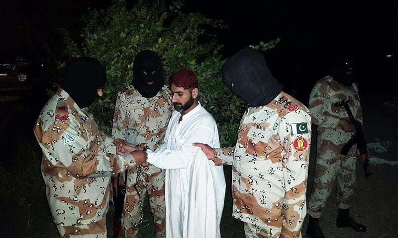 A photo released by Rangers shows Uzair Baloch being handcuffed by the paramilitary force.—Photo courtesy: PRO
