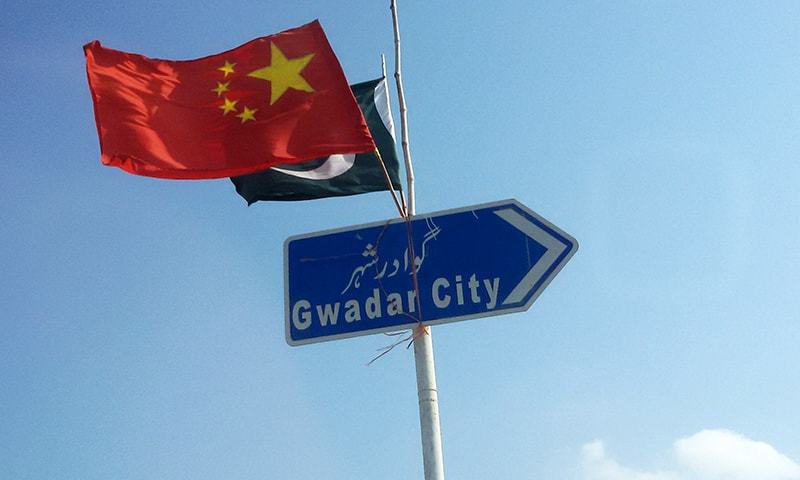 The Chinese and Pakistani flags fly on a sign along a road towards Gwadar. -Reuters