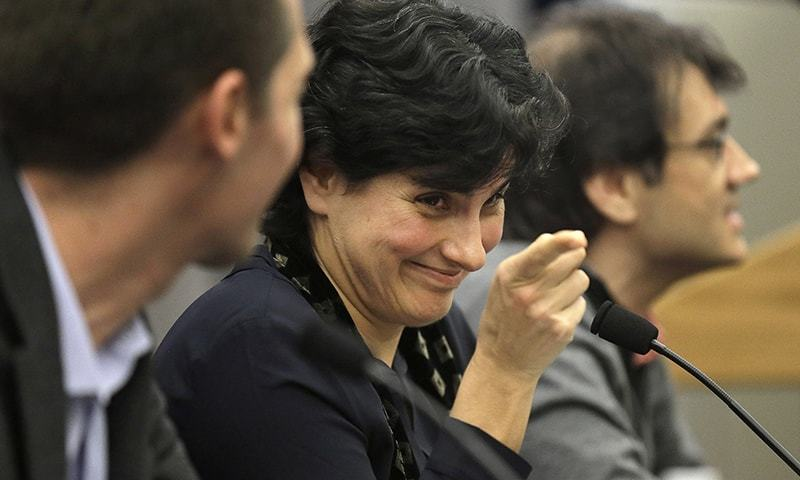 Massachusetts Institute of Technology astrophysics professor Nergis Mavalvala, center, addresses an audience of scientists and journalists as MIT physics professor Matthew Evans, left, and MIT research scientist Erik Katsavounidis, right, look on during a presentation on the discovery of gravitational waves, Thursday, Feb. 11, 2016, on the school's campus, in Cambridge, Mass. —AP