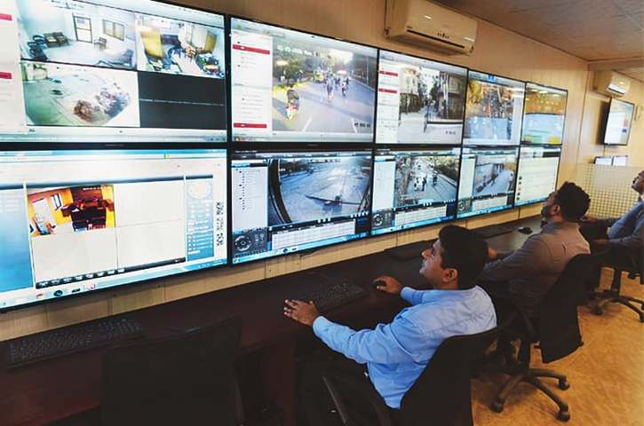 Officials at an ops room in the Ghalib Market police station on Monday monitor screens with feeds from surveillance cameras installed in various parts of Lahore.—Azhar Jafri / White Star