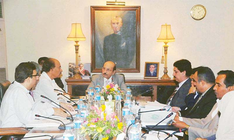 SENIOR Minister for Education and Literacy Nisar Ahmed Khuhro gives a briefing to Chief Minister Syed Qaim Ali Shah on his department's schemes at a meeting held at CM House on Wedneday.