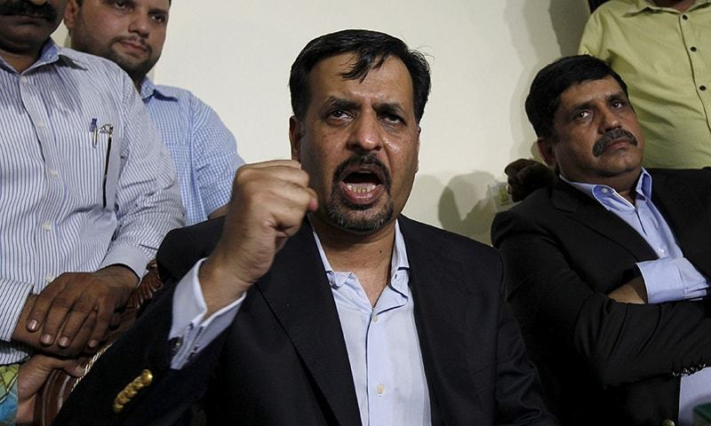 Mustafa Kamal gestures during the news conference in Karachi. ─Reuters