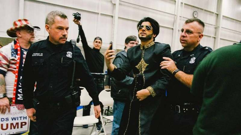 Saqib Javed being escorted out of a Trump rally in Michigan. Photo: Robert Lee Bailey