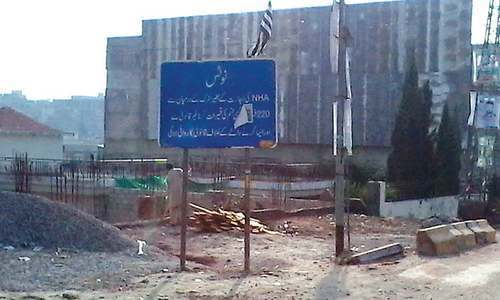 NHA has installed a signboard which prohibits construction at Bhara Kahu. The other picture shows work continuing in the same area. — Photos by the writer