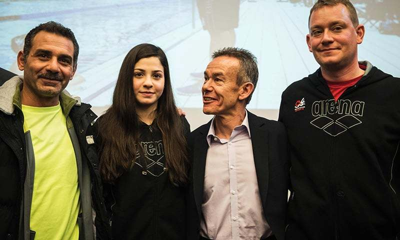 Syrian swimmer Yusra Mardini (2ndL), her father Izzat (L), coach Sven Spannekrebs (2ndR) and Pere Miro of the International Olympic Committee (IOC) pose for a picture after a press conference in Berlin on March 18, 2016.—AFP
