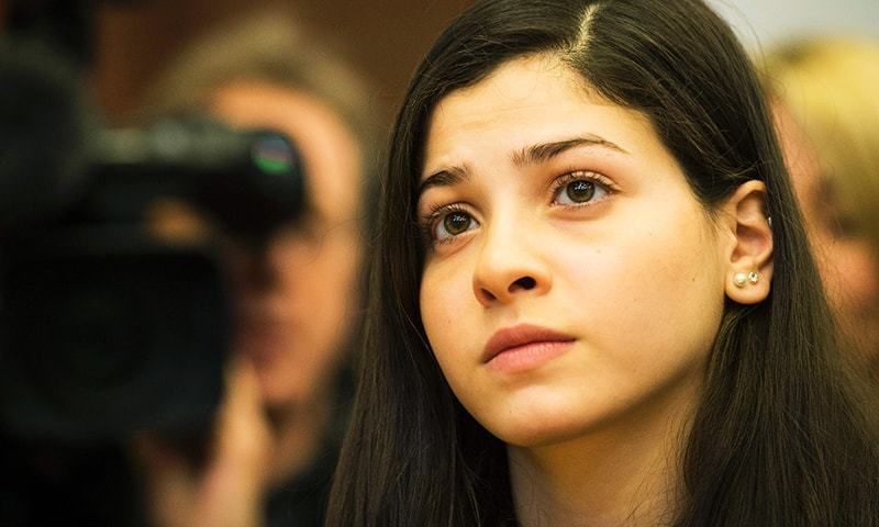 Syrian swimmer Yusra Mardini attends a press conference in Berlin on March 18, 2016.-AFP