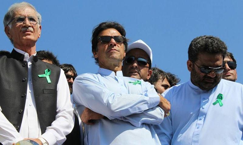 Imran Khan, accompanied by Pervaiz Khattak, planted trees at Regi Model Town. —Photo courtesy PTI