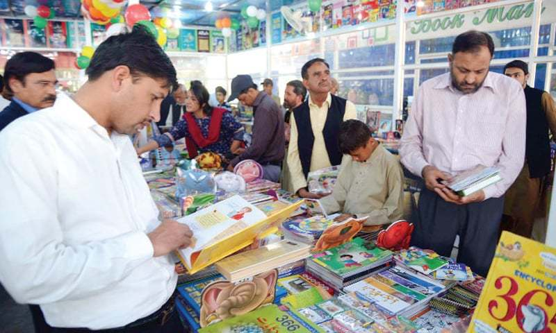 Visitors look at books at Shehr-e-Kitab after its inauguration on Sunday. — Photo by Ishaque Chaudhry