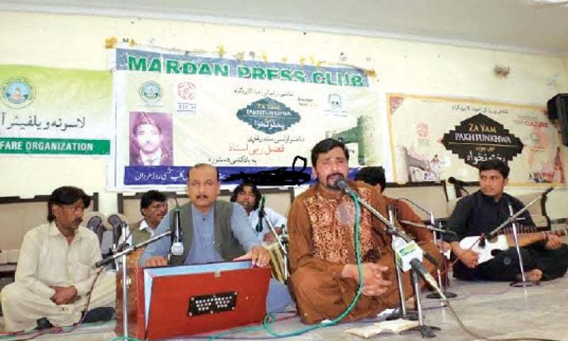 A singer performs at a function held in Mardan to pay homage to Fazal-i-Rabi Ustad. — Dawn