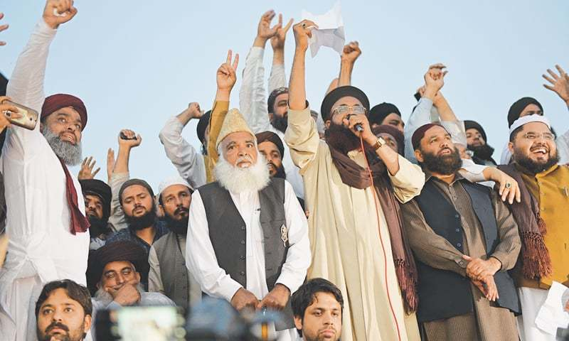 ISLAMABAD: Leaders of Sunni Tehreek and other religious parties address protesters at D-Chowk here on Wednesday. —Photo by Tanveer Shahzad/White Star