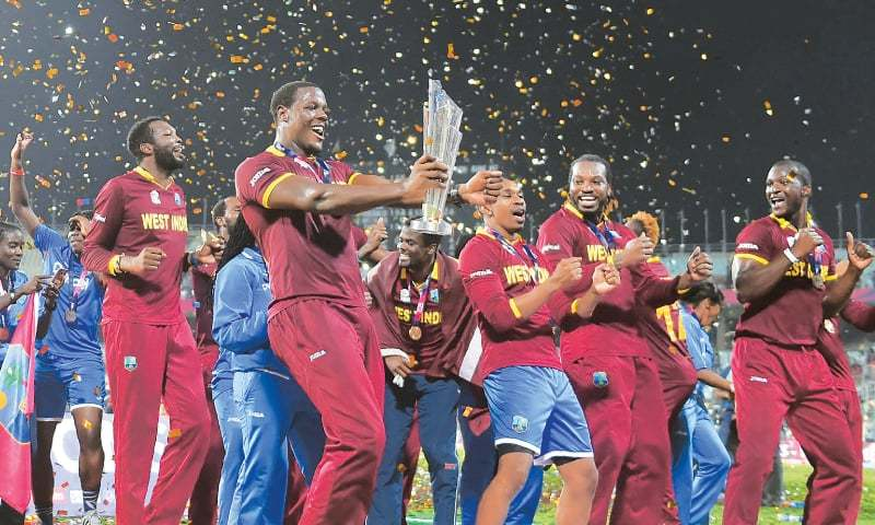 CARLOS Brathwaite of West Indies holds the trophy as he celebrates after winning the World T20 final against England at The Eden Gardens Cricket Stadium in Kolkata on Sunday.—AFP
