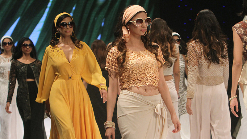 Models present creations by designer Natasha Kamal during Pakistan Fashion Week in Karachi.─AP