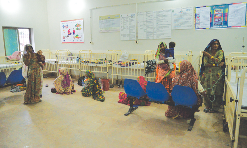 Clockwise: The paediatrician ward at District Hospital Mithi; a baby in an incubator at the hospital; a Thari woman tends to her malnourished child