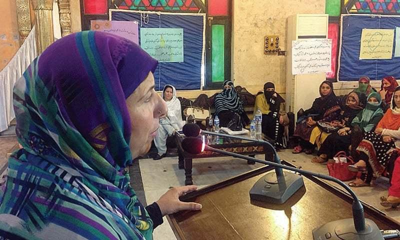 Pashto poet Haseena Gul addresses the literary gathering in Peshawar on Friday. — Dawn