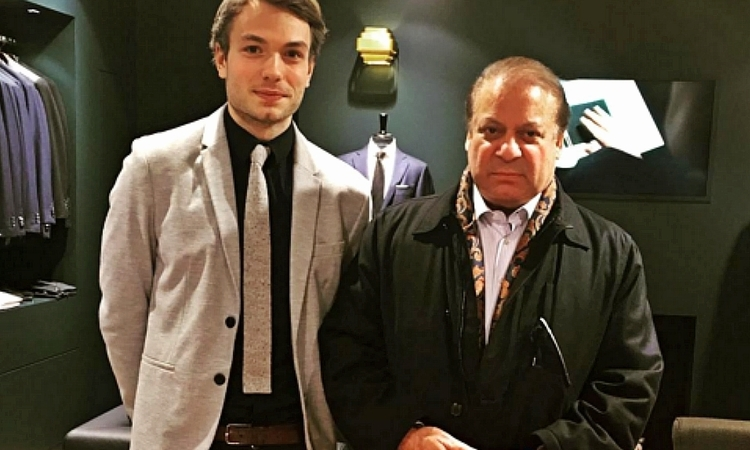A retail assistant at Scabal was excited to take a picture with PM Nawaz, though he thought he was suiting up the Pakistani President -  Screengrab