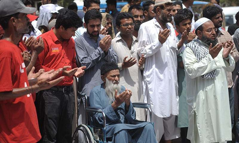 Edhi sits on a wheelchair as he offers funeral prayers for unclaimed heatwave victims on June 26, 2015. ─ AFP/File