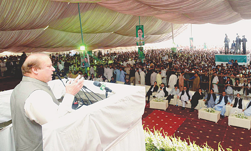KOTLI SATTIYAAN: Prime Minister Nawaz Sharif speaks at a ceremony held here on Monday for distribution of relief cheques among people affected by rain.—PPI