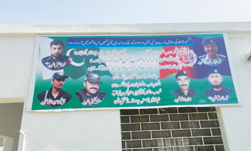 THE outer wall of the Bangla Ichha police station in a village in Rojhan, Rajanpur district, bears a banner featuring six policemen who were killed on April 13 during a police operation against Chhotoo gang criminals.—Photo by writer