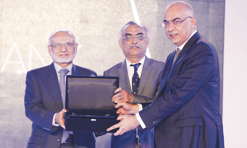 KARACHI: United Bank President and CEO Wajahat Hussain (right) receives the award for best bank from Chairman of Institute of Bankers Pakistan Hussain Lawai (left) and Partner A.F. Ferguson Shabbar Zaidi at the first Pakistan Banking Awards held at the Mohatta Palace on Friday night.