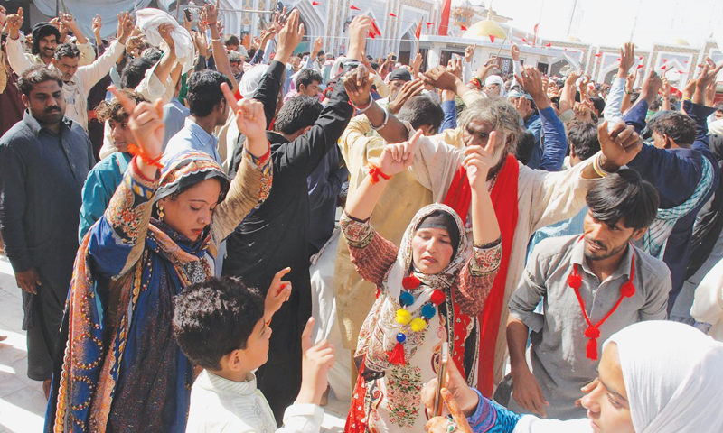 DEVOTEES dance in the courtyard of the Qalandar shrine at Sehwan on Friday.—INP