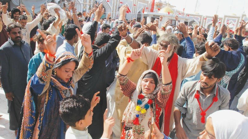 Devotees dance in the courtyard of the Qalandar shrine at Sehwan on Friday.