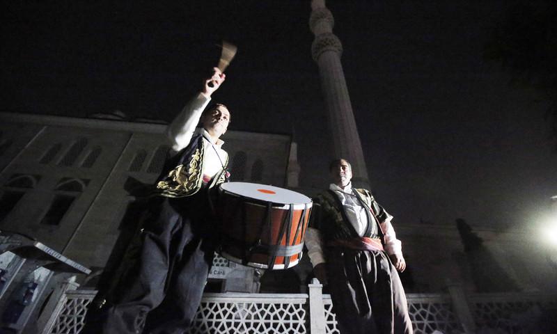 A drummer performs in an Istanbul neighbourhood. —AP