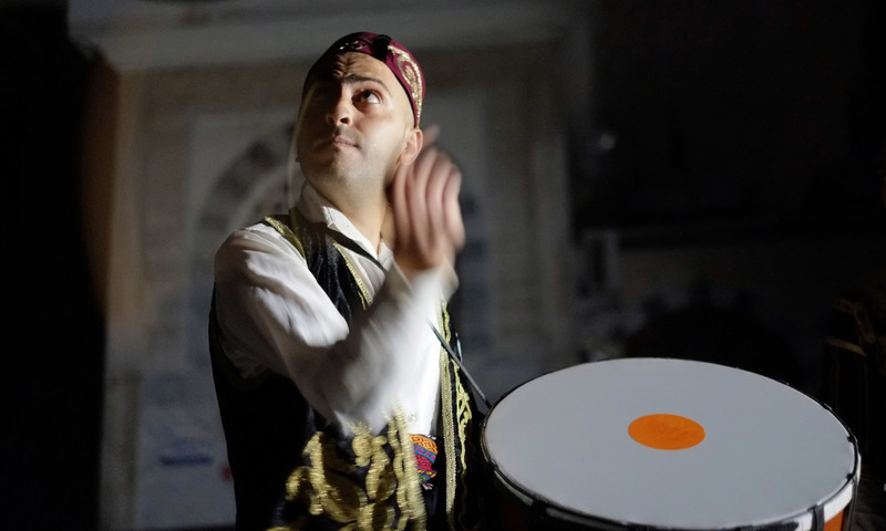 """The drummers wander the streets to wake up residents for """"sahur"""". —AP"""
