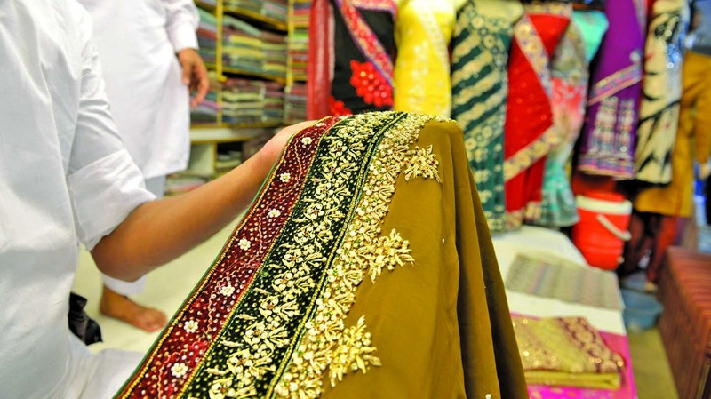 faisalabad shopkeepers find big bucks in replica designer suits style images
