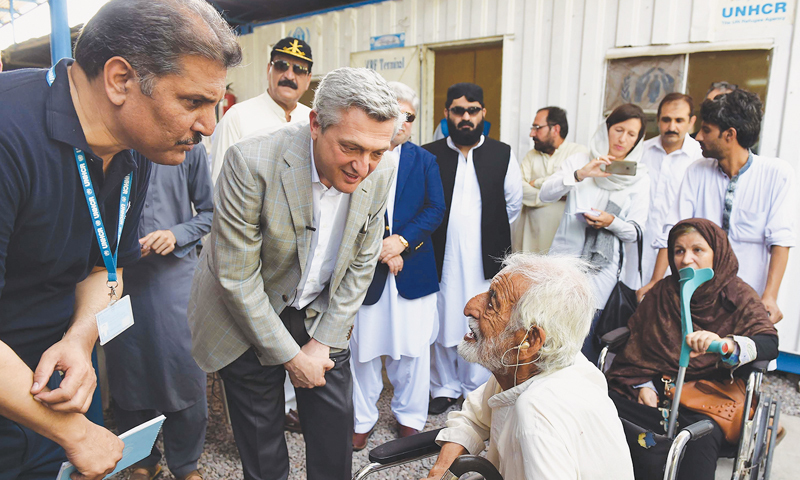 PESHAWAR: United Nations High Commissioner for Refugees Filippo Grandi talks to a disabled Afghan refugee at a repatriation centre in Chamkani area of Daag Behsud, Nowshera district, on Thursday.—Abdul Majeed Goraya