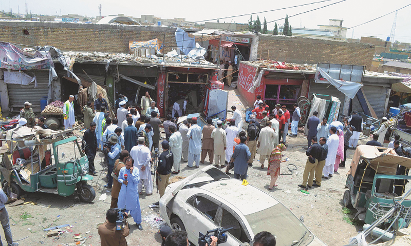 QUETTA: Security personnel and other people pictured at the site of the bomb explosion on Friday.—AFP