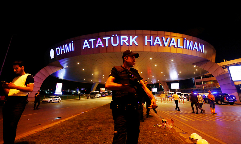 A riot police officer stands guard at the entrance of the Ataturk airport in Istanbul, Turkey, following a multiple suicide bombing, early June 29, 2016.— Reuters