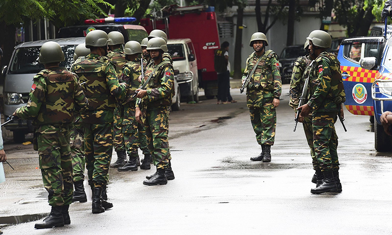 Bangladeshi army soldiers stand guard during a rescue operation to free the hostages.— AFP